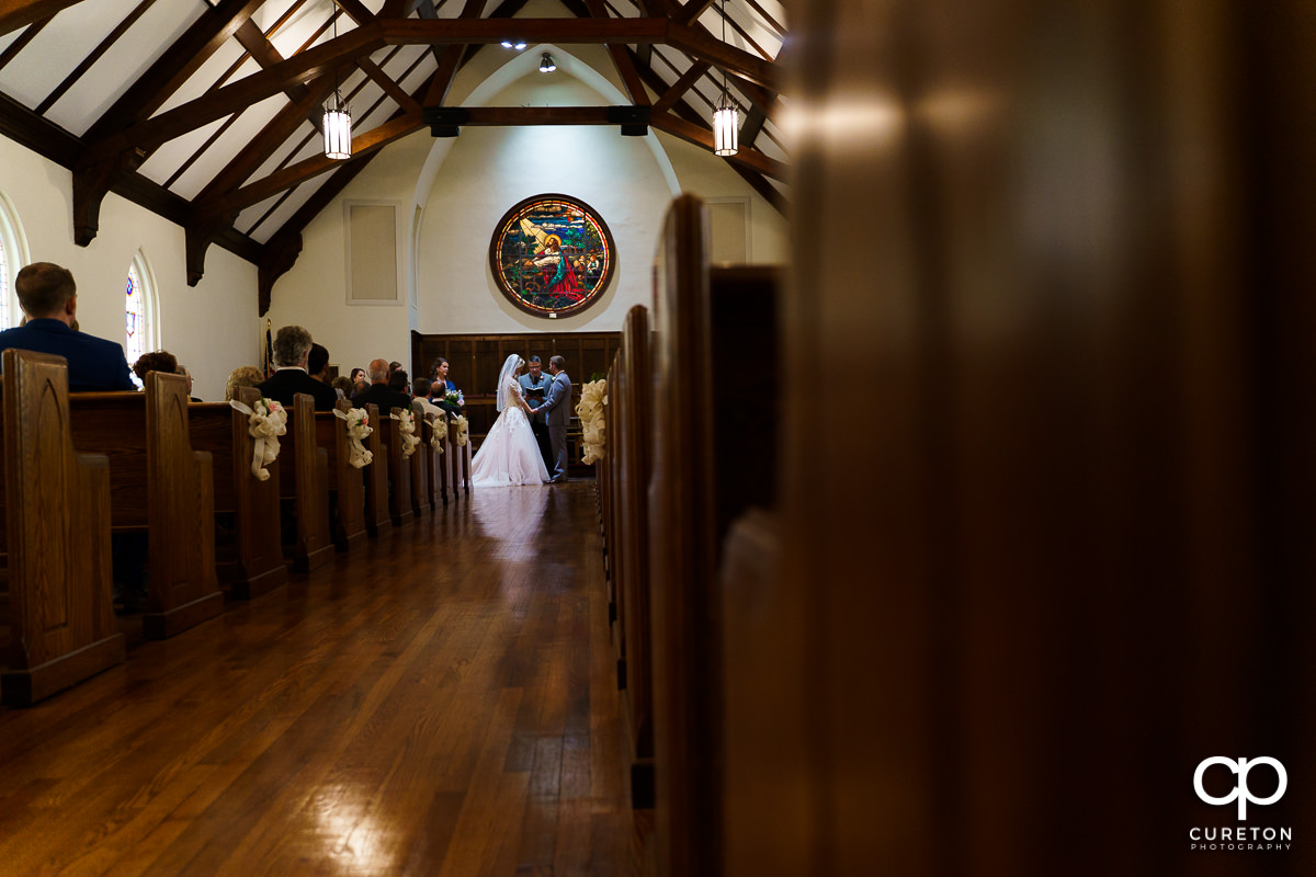 Bride and groom at the alter in the church.