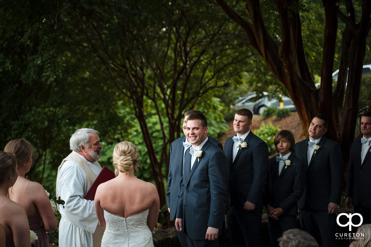 Groom laughing at the wedding ceremony.