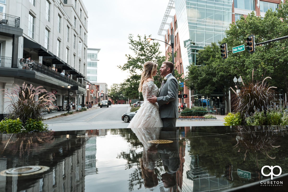 Bride and groom walking in downtown Greenville,SC.