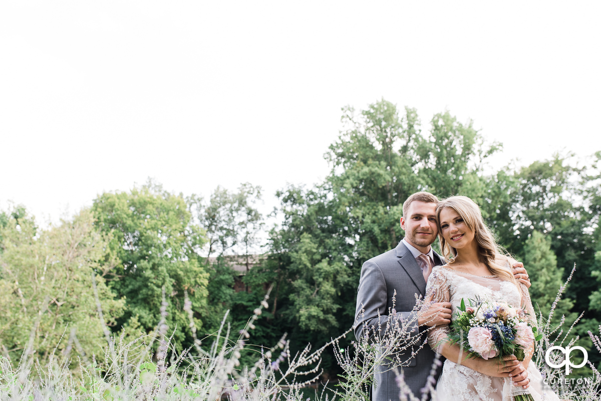 Bride and groom in Falls Park after their wedding at Mary's cottage in downtown Greenville,SC.