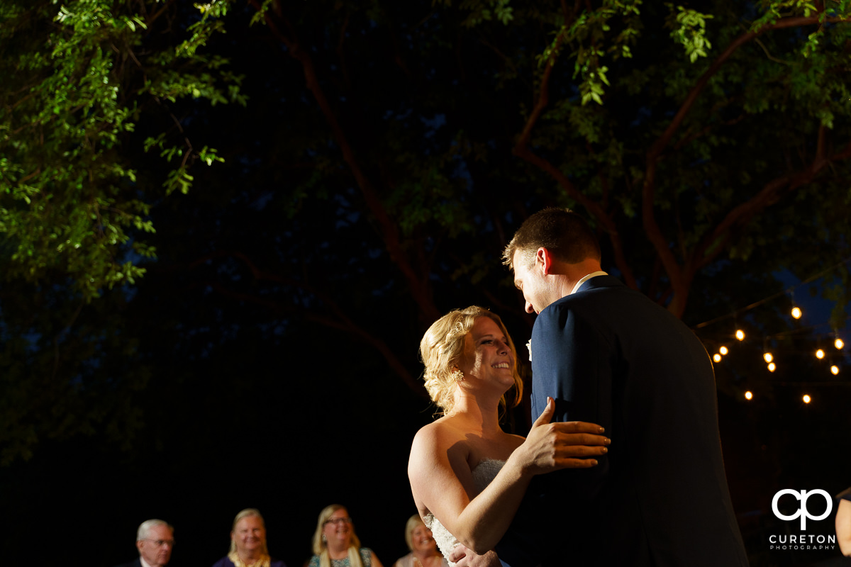 Bride and groom sharing a first dance at the wedding reception at Mary's at Falls Cottage.