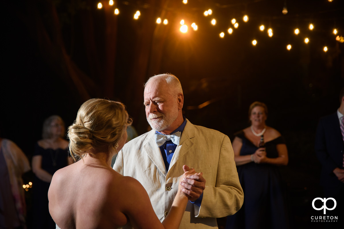 Bride and her father sharing a first dance at the wedding reception at Mary's at Falls Cottage.