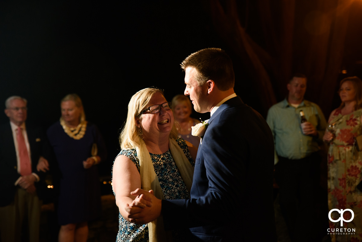 Groom and his mom sharing a first dance at the wedding reception at Mary's at Falls Cottage.