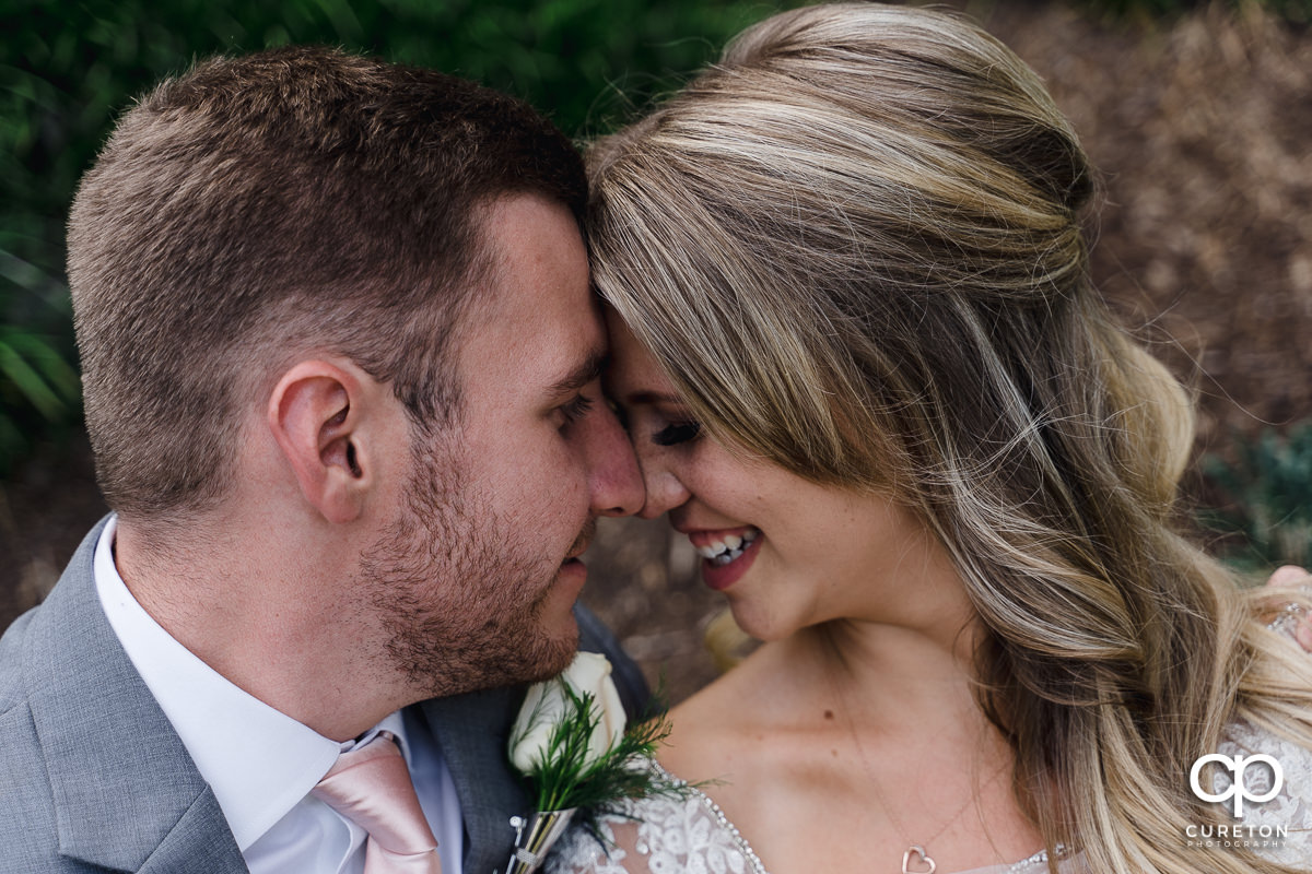 Bride and groom nose to nose after their wedding in Greenville,SC.