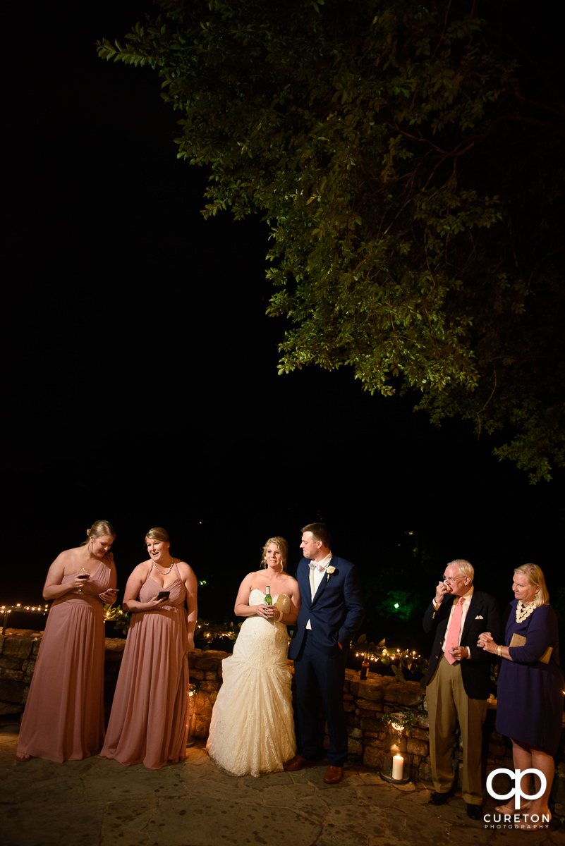 Bridesmaids giving a speech at the wedding reception.