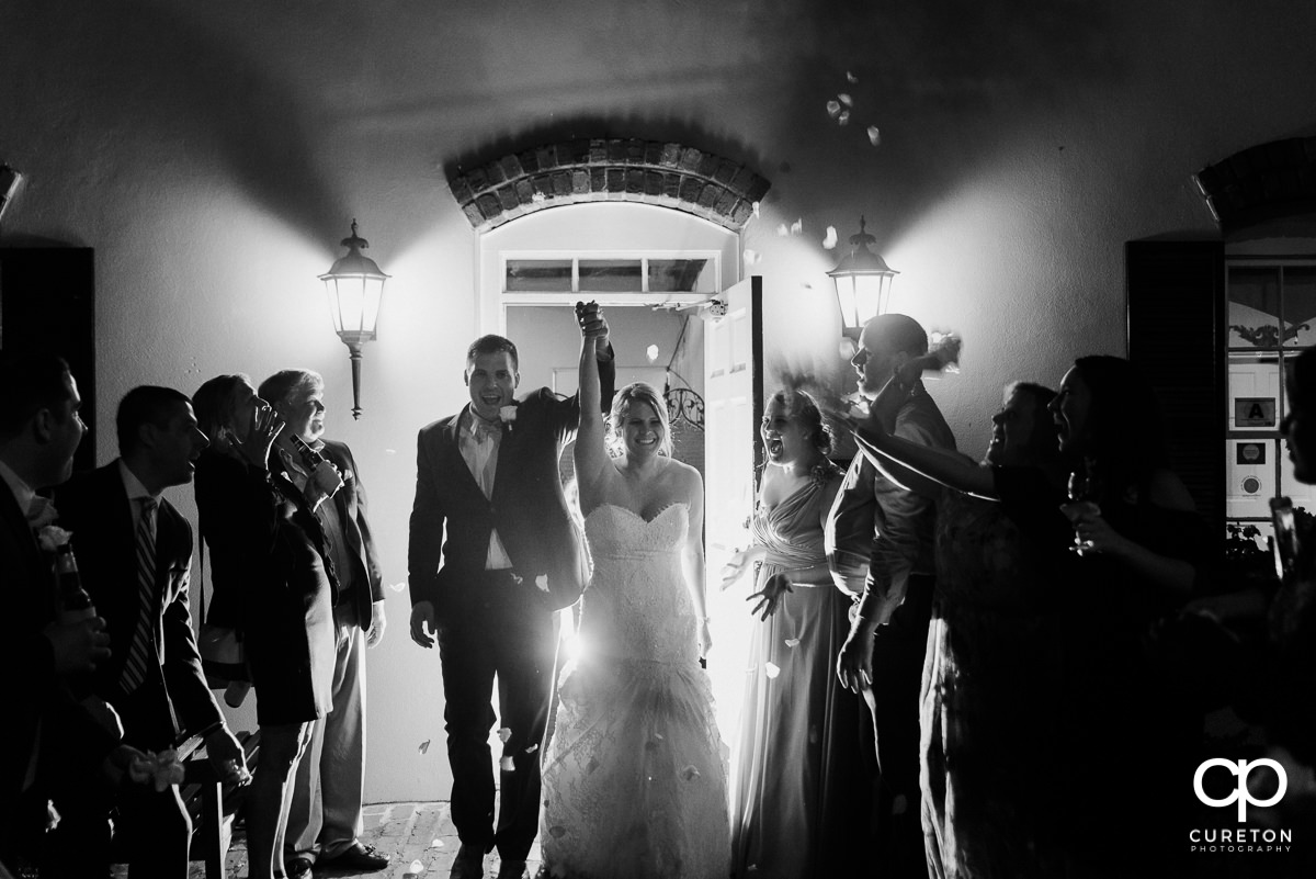Bride and groom making a grand exit.