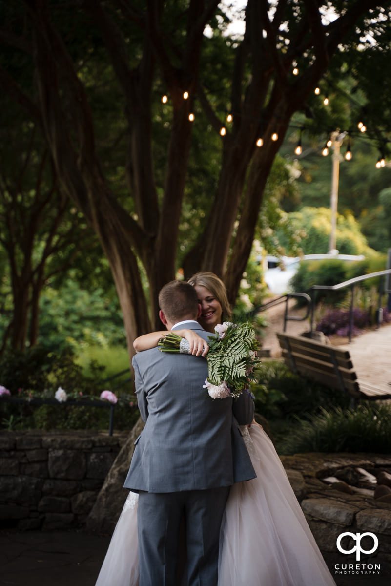 Bride and groom sharing a private dance at their wedding reception at Mary's cottage at Falls Park in downtown Greenville,SC.