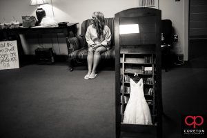 Bride and her dress in the mirror.