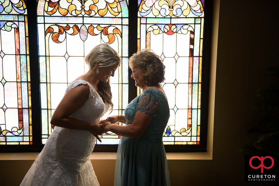 Bride and her mom before their wedding at Mitchell Road Presbyterian Church.