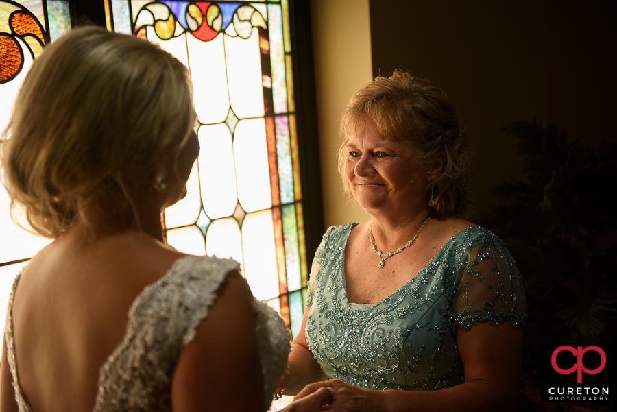 Bride's mom looking at the bride.