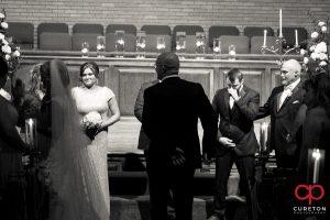 Groom breaks down as he sees his bride.