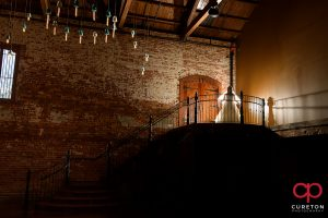 Jessica on the top of the stairs during her Old Cigar Warehouse bridal session.