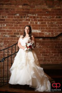 Bride on the steps inside the Old Cigar Warehouse in downtown Greenville,SC.