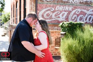 Engaged couple hugging at their Old Cigar Warehouse engagement session.