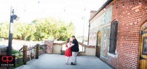 Engaged couple on the deck of The Old Cigar Warehouse.