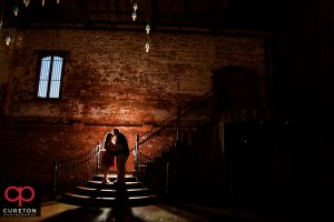 Epic shot of a couple during their engagement session at The Old Cigar Warehouse.