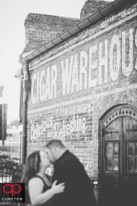 Black and white vintage photo of a couple during their engagement session at The Old Cigar Warehouse.