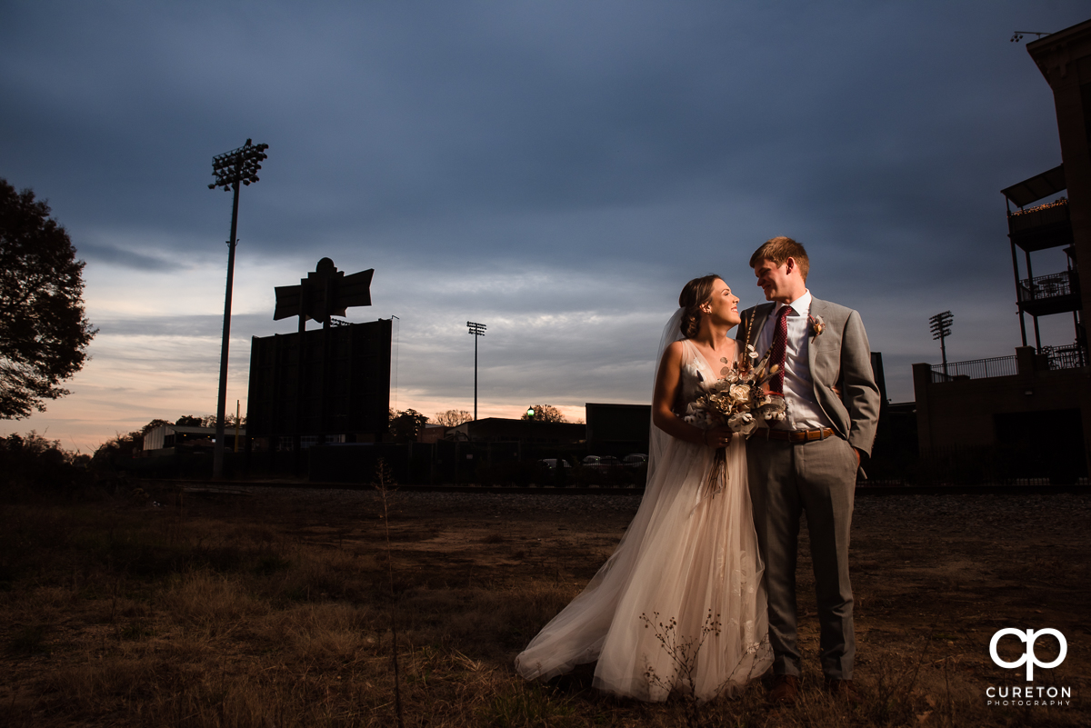 Husband and wife at sunset after their wedding ceremony at The Old Cigar Warehouse in Greenville,SC.
