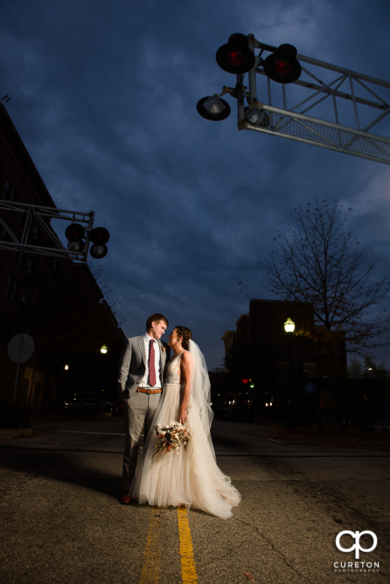 Bride and groom standing in the middle of the Main Street in downtown Greenville,SC.