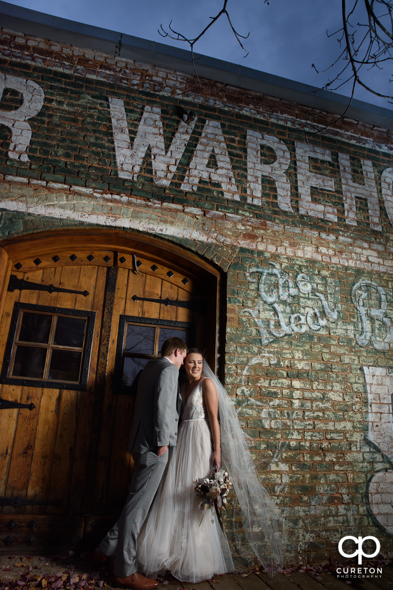 Bride and groom on the back deck at The Old Cigar Warehouse.