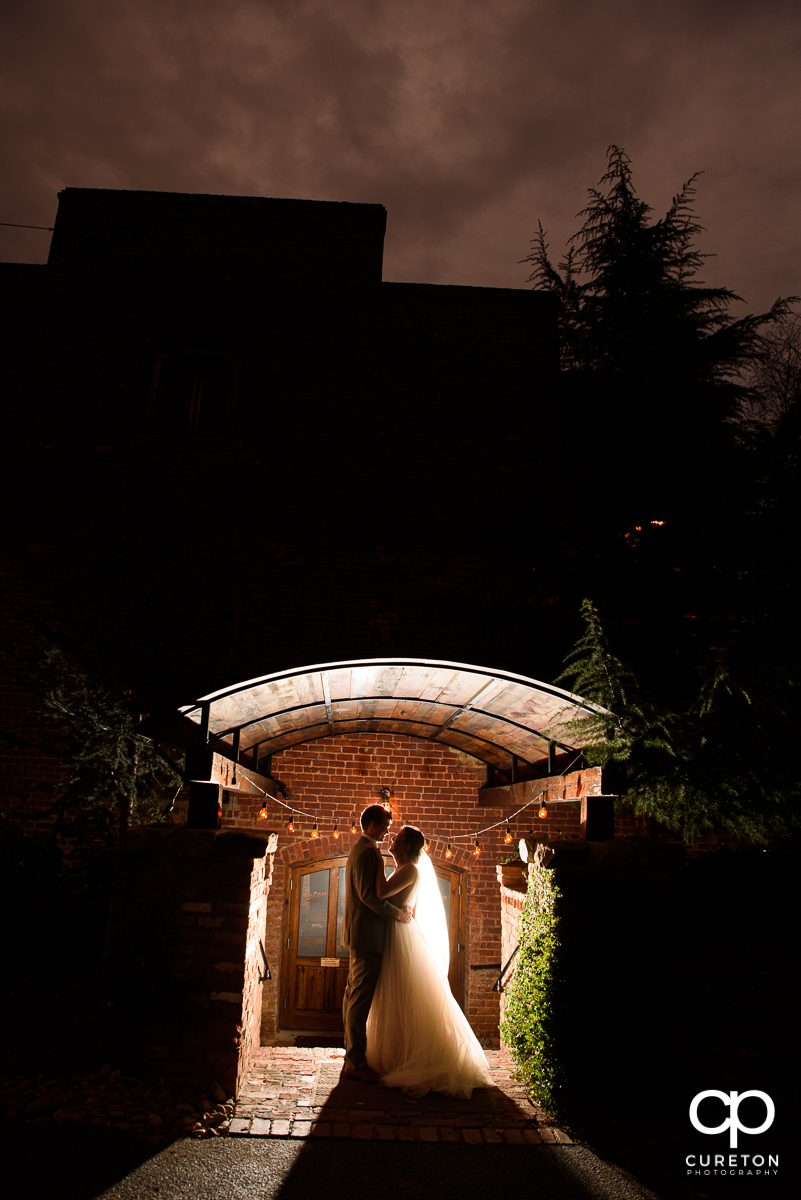 Groom and bride at sunset after their wedding ceremony at The Old Cigar Warehouse in Greenville,SC.