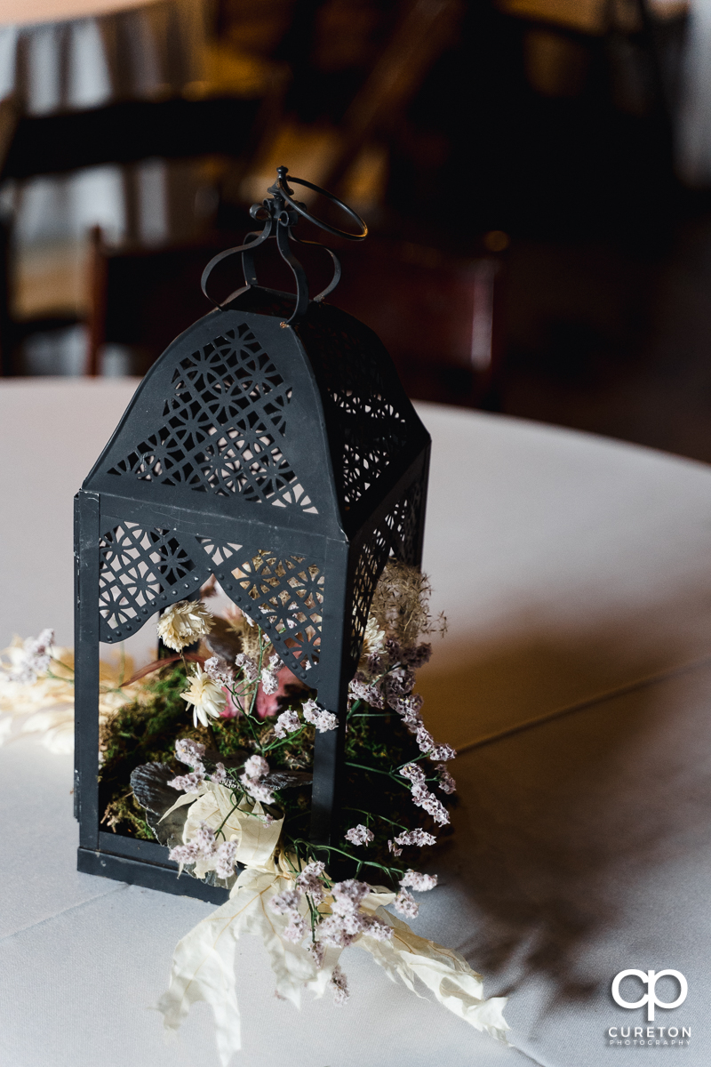 Table centerpieces by Frilly Bloomers.