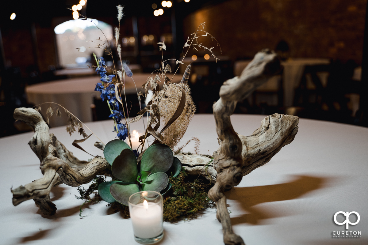 Centerpieces at the wedding reception .