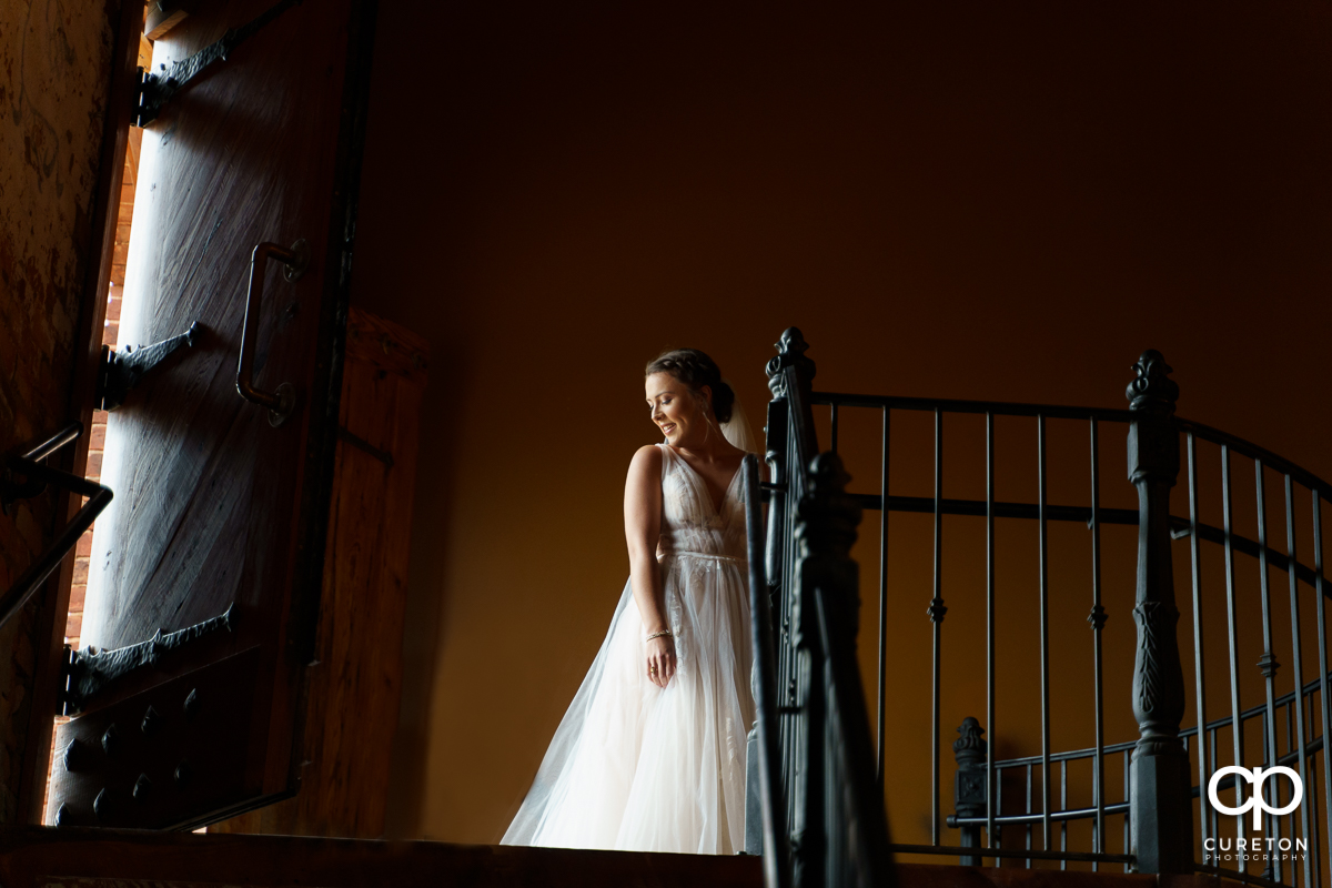 Bride making her grand entrance at the wedding ceremony at The Old Cigar Warehouse.