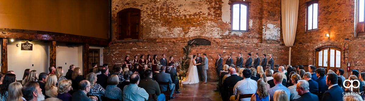 Panorama of a wedding ceremony at The Old Cigar Warehouse.