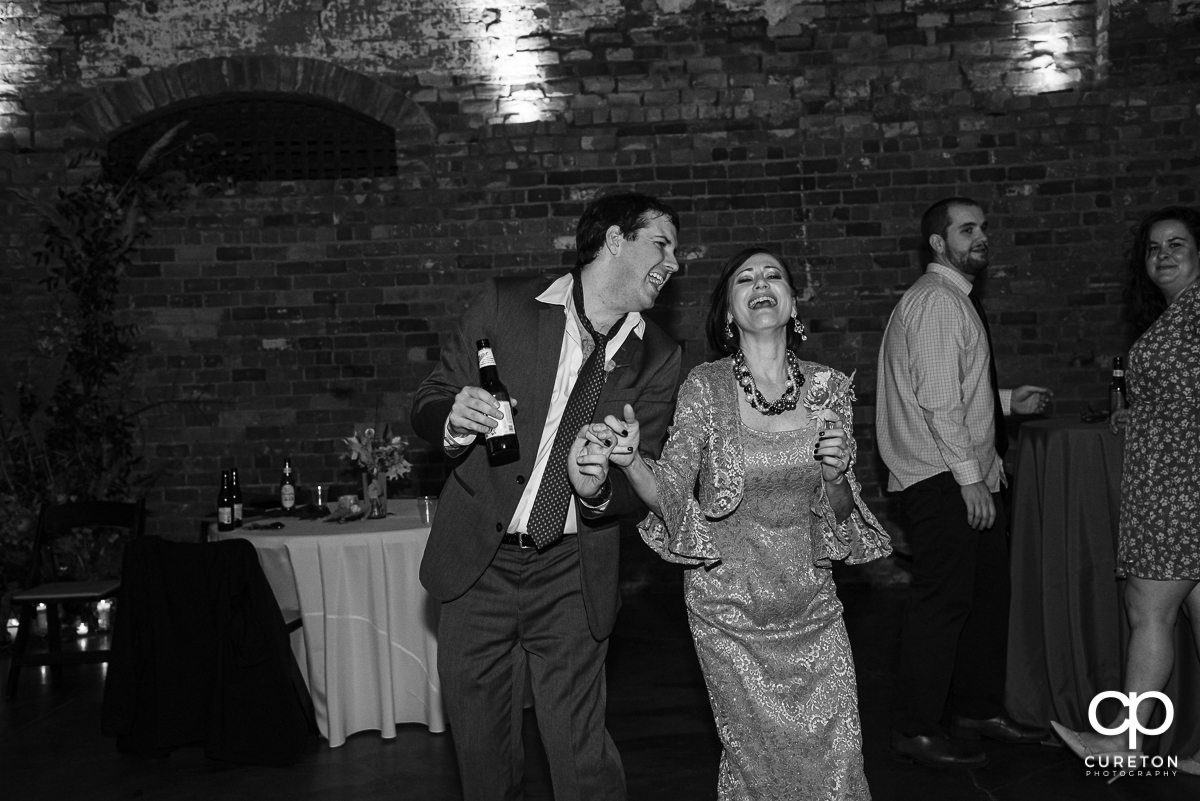 Guests dancing to the sounds of Jumping Jukebox at the Old Cigar Warehouse reception.