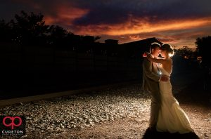 Bride and Groom dancing at sunset after their Old Cigar Warehouse wedding in downtown Greenville,SC.