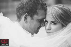Black and white closeup of a bride and groom.
