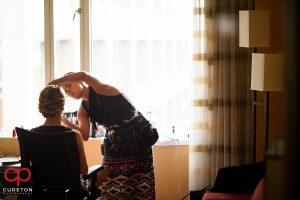 Katie Cotton applying bridal makeup.