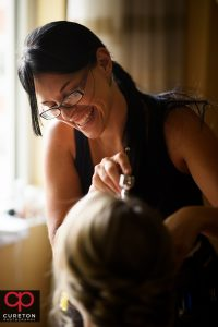 Katie Cotton from Cotton Rouge and Co. applying airbrush bridal makeup in downtown Greenville,SC.