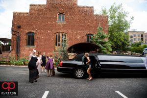 Bride getting out of a limo.