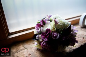The bride's bouquet sitting in the window.