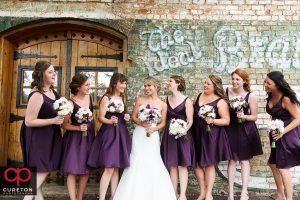Bridesmaids looking at the bride.