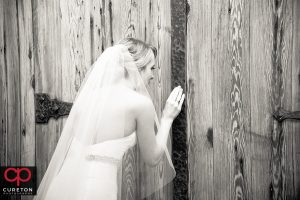 Bride peeking through the door before walking down the aisle.