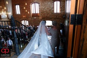Bride walking down the stairs.