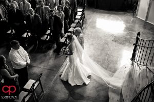 Bride and her mom walking down the aisle.