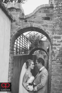 Black and white of Bride and Groom outside the Old Cigar Warehouse.