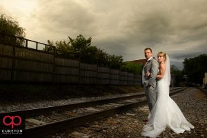Epic shot of the bride and groom on the tracks.