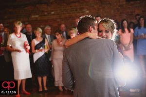 Bride and groom sharing a first dance at The Old Cigar Warehouse wedding reception.