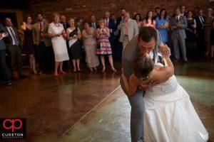 Groom dips his bride.