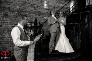 The best man giving the couple a toast.