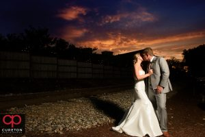 The bride and groom at sunset in downtown Greenville,SC.