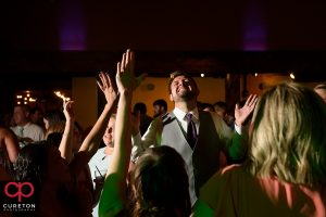 Wedding guests dancing to the sounds of Uptown Entertainment.