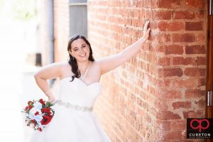 Smiling bride outside the Old Cigar Warehouse.