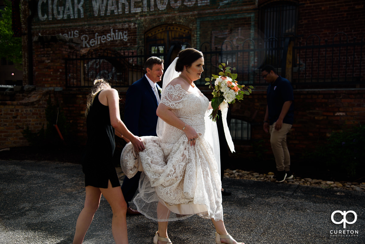Bride being helped to the deck at Old Cigar Warehouse.