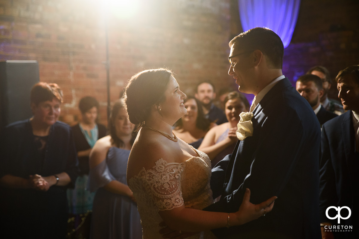 Bride and groom sharing a first dance at the Old Cigar Warehouse wedding reception in Greenville,SC.